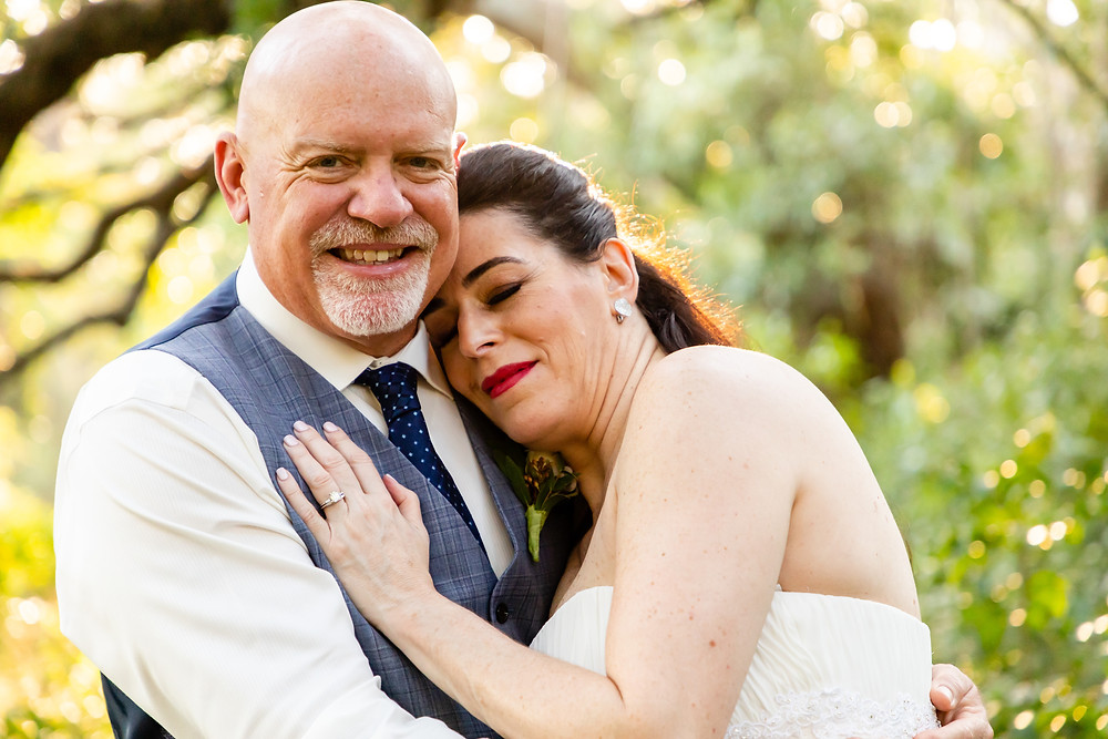 Cincinnati wedding photographer captures image of husband and wife hugging each other smiling for a picture.