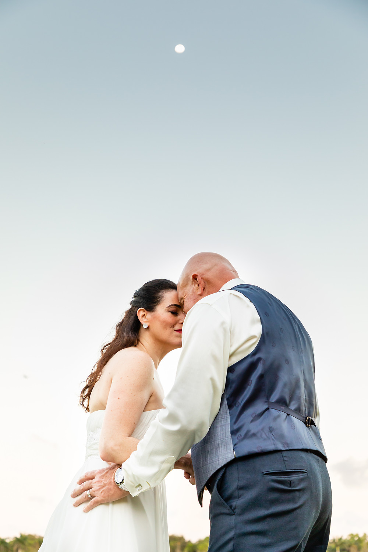 Cincinnati wedding photographer captures image of husband and wife hugging under the moon.