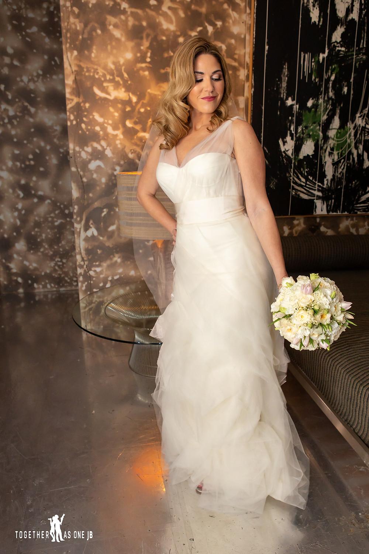 Bride posing in bridal suite in the M Building in Wynwood