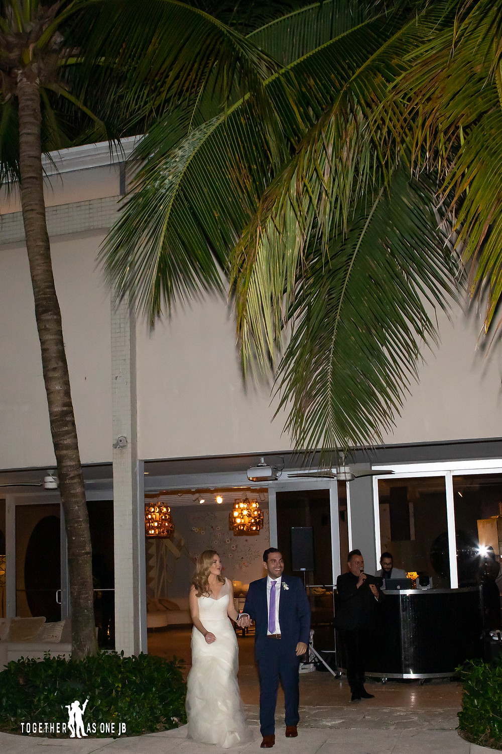Wedding couple entering reception at the M Building in Wynwood
