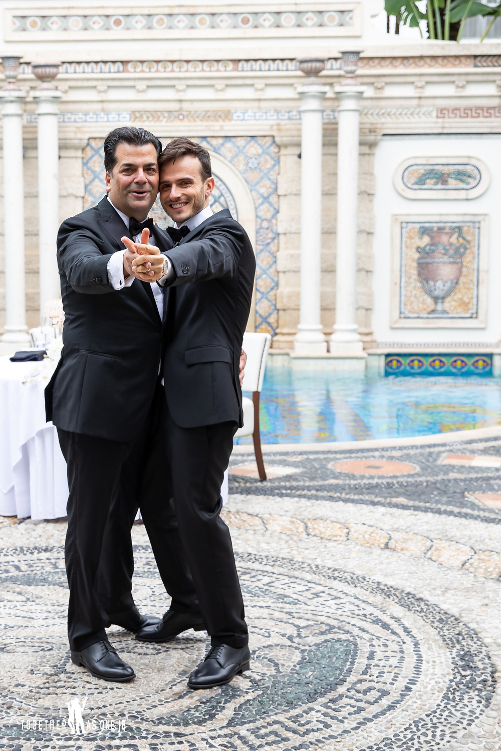 Wedding couple dance in front of Versace Mansion pool