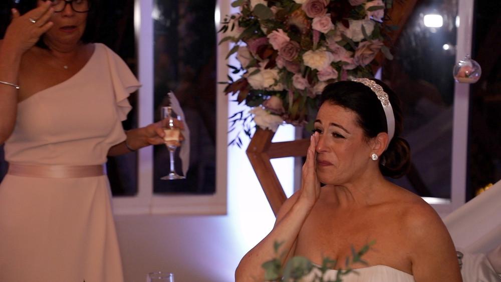 Cincinnati wedding photographer captures image of bride tearing up in wedding ceremony.