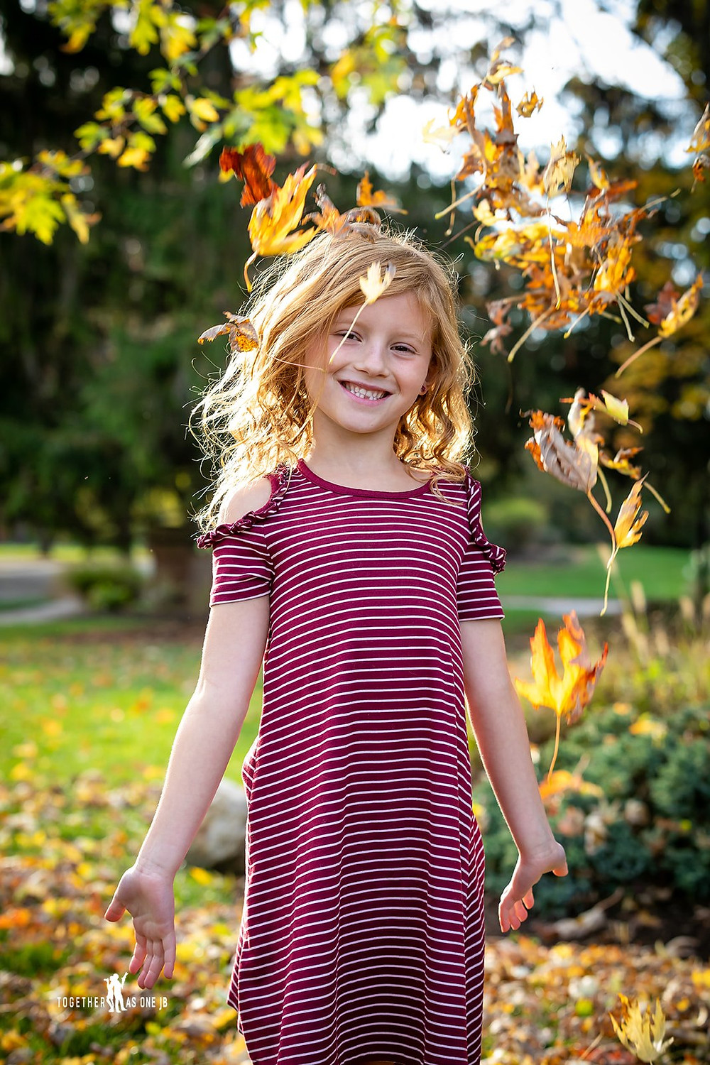 Cincinnati family photographer captures portrait photography of smiling ginger girl in autumn.