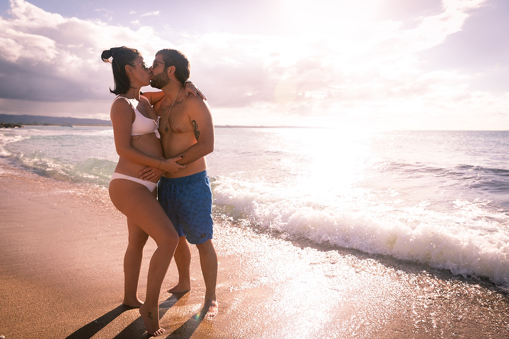Engagement wedding photographer captures image of couple kissing in the beach in Puerto Rico.
