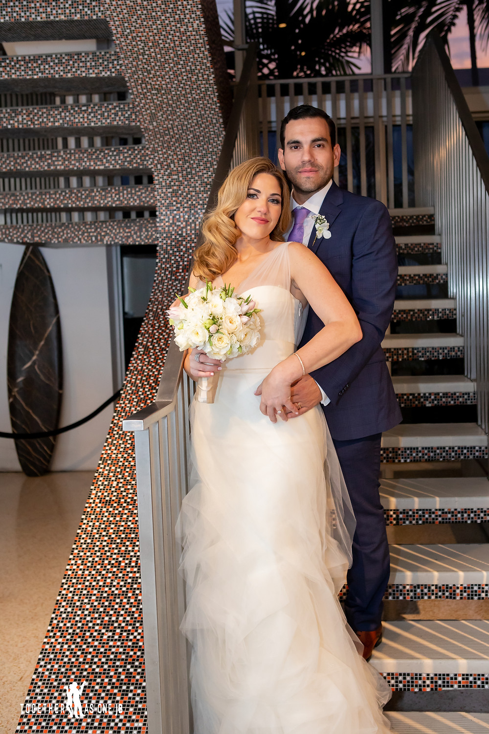 Bride and Groom posing on stairs after wedding ceremony in the M Building in Wynwood