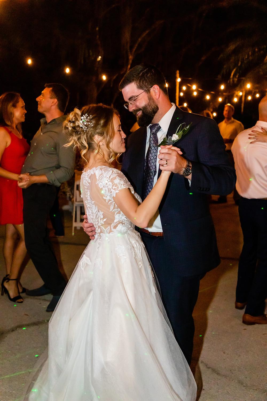 Cincinnatti wedding photographer captures image of groom and bride dancing in the night.