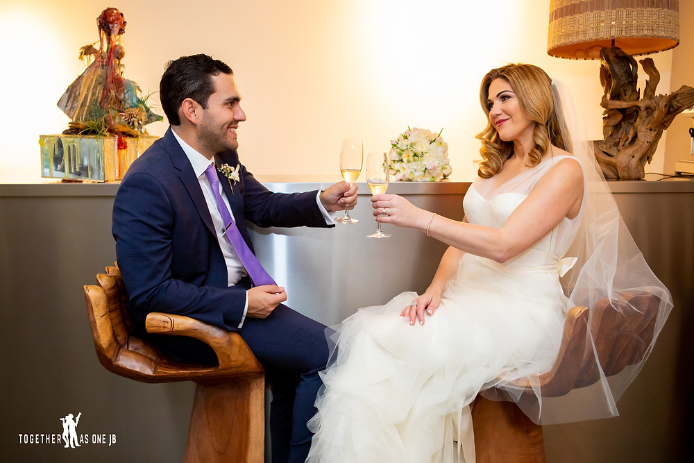 Bride and Groom celebrating with a champagne toast in the M Building in Wynwood