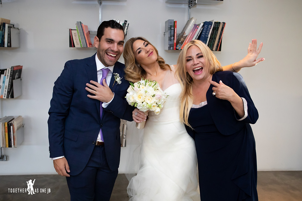Bride and Groom with Groom's mother laughing after wedding ceremony in the M Building in Wynwood