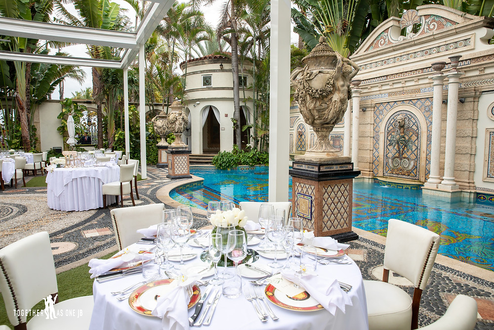Wedding dinner tables ready for wedding guests by famous Gianni's pool area