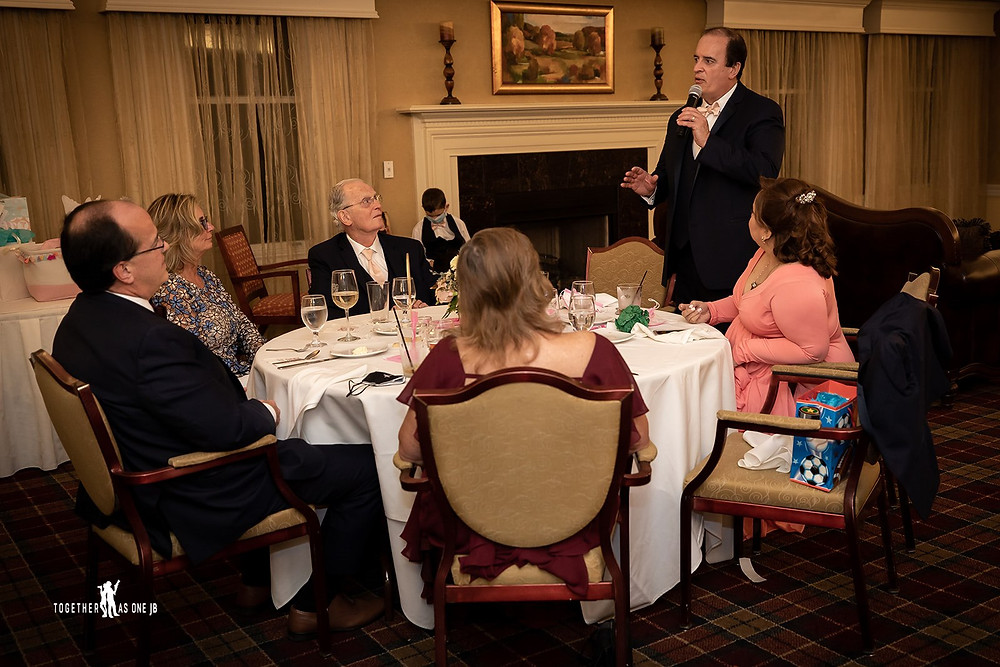 Cincinnati family photographer captures image of father giving a speech in fancy baby shower.