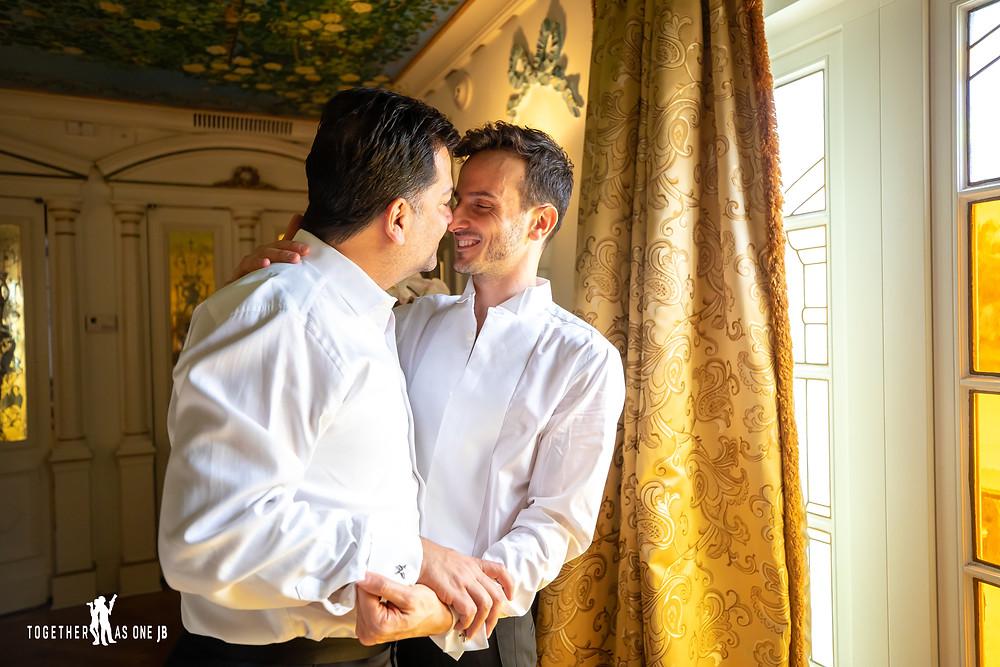 Groom hugging groom before wedding ceremony at the Villa Casa Casuarina