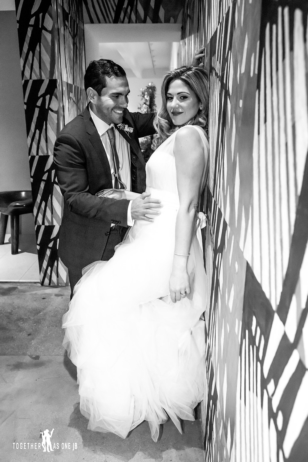 Bride and Groom posing in front of wall mural in the M Building in Wynwood