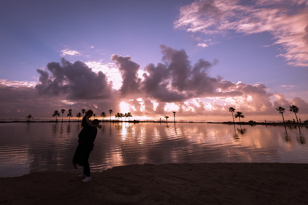 Miami wedding photographer captures image of couple silhouette in the beach at sunset.