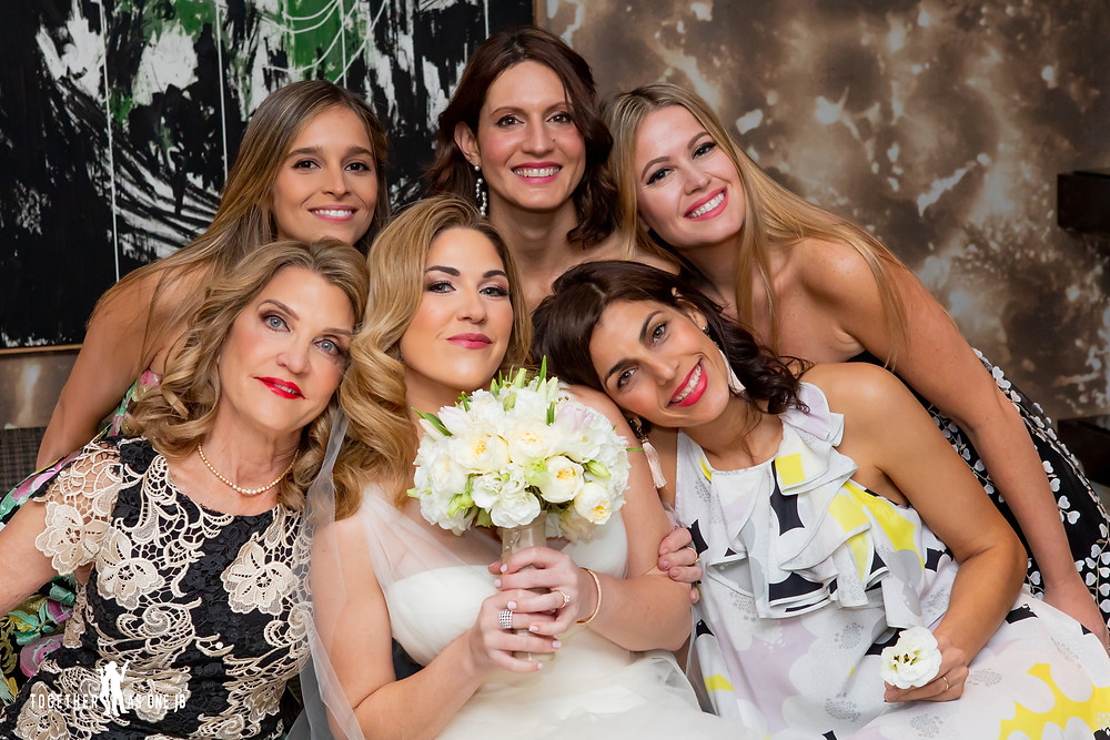 Bride with bridesmaid and mom in bridal suite in M building in Wynwood