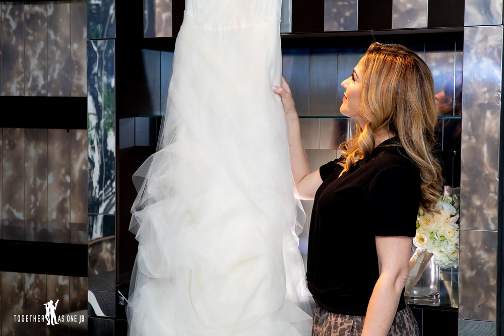 Bride looking at wedding dress in bridal suite at the M building in Wynwood