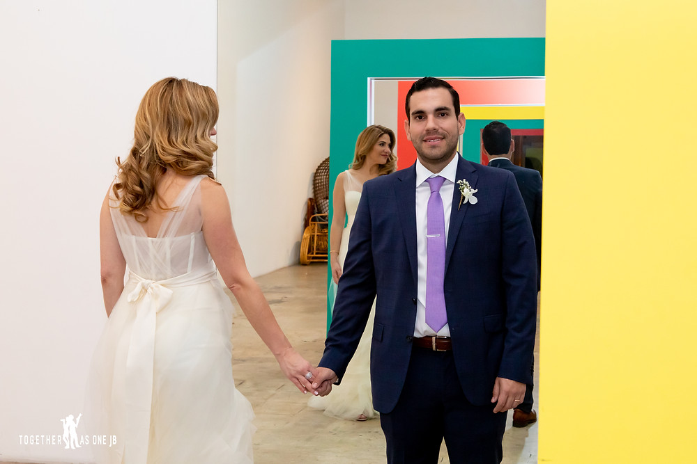 Bride and Groom posing in art installation in the M Building in Wynwood