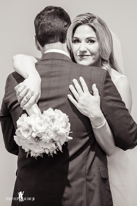 Bride and Groom hugging in the M Building in Wynwood