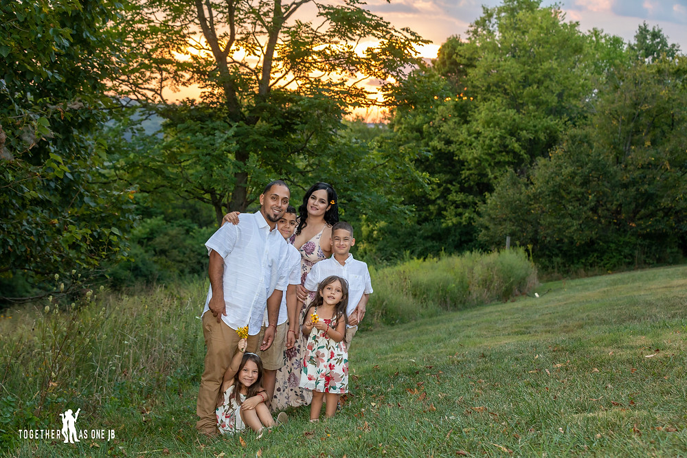 Family portrait photography taken during sunset at Mount Snow Park in Cincinnati Ohio.  The Sun was setting creating the most beautiful colors of the day