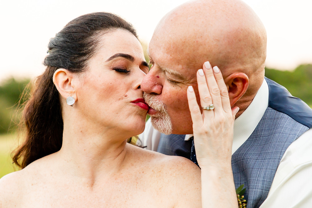 Cincinnati wedding photographer captures image of husband and wife kissing from the side.