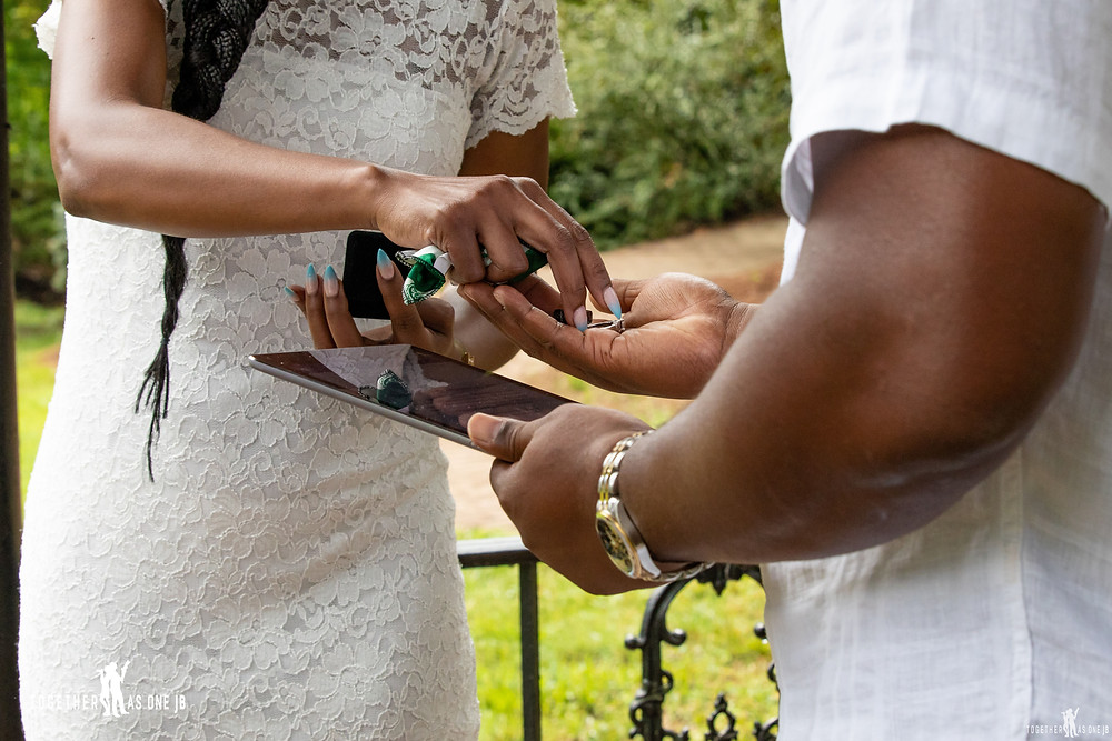 close up of ring exchange during wedding ceremony at a small intimate wedding in Mt. Airy park in Cincinnati