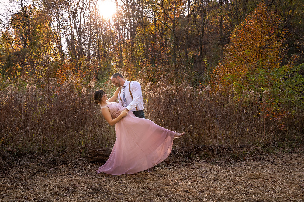 Cincinnati wedding photographer captures image of groom dipping wife in forest.