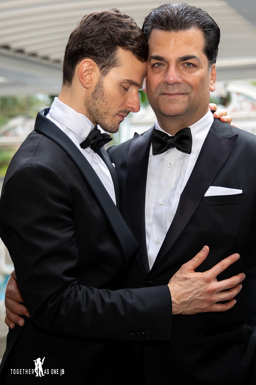 Close up of grooms embracing