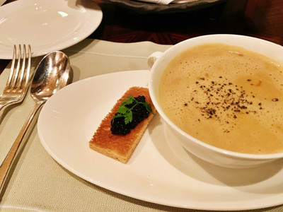 Lobster soup with caviar on toast