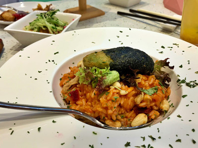 Vegetarian risotto with fried avocado
