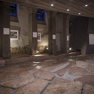 Exhibit along buried Roman road in Trento, Italy