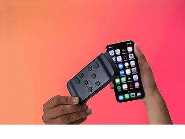 Picture of the Hable One and an iPhone in front of an orange background