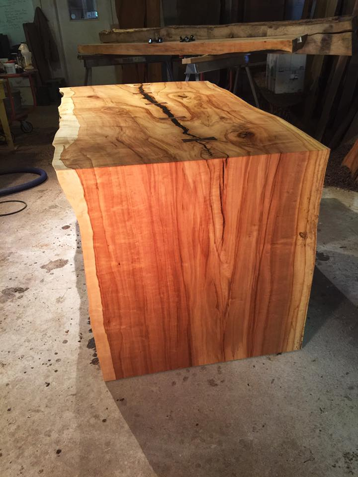 Spalted Maple waterfall desk with Walnut leg