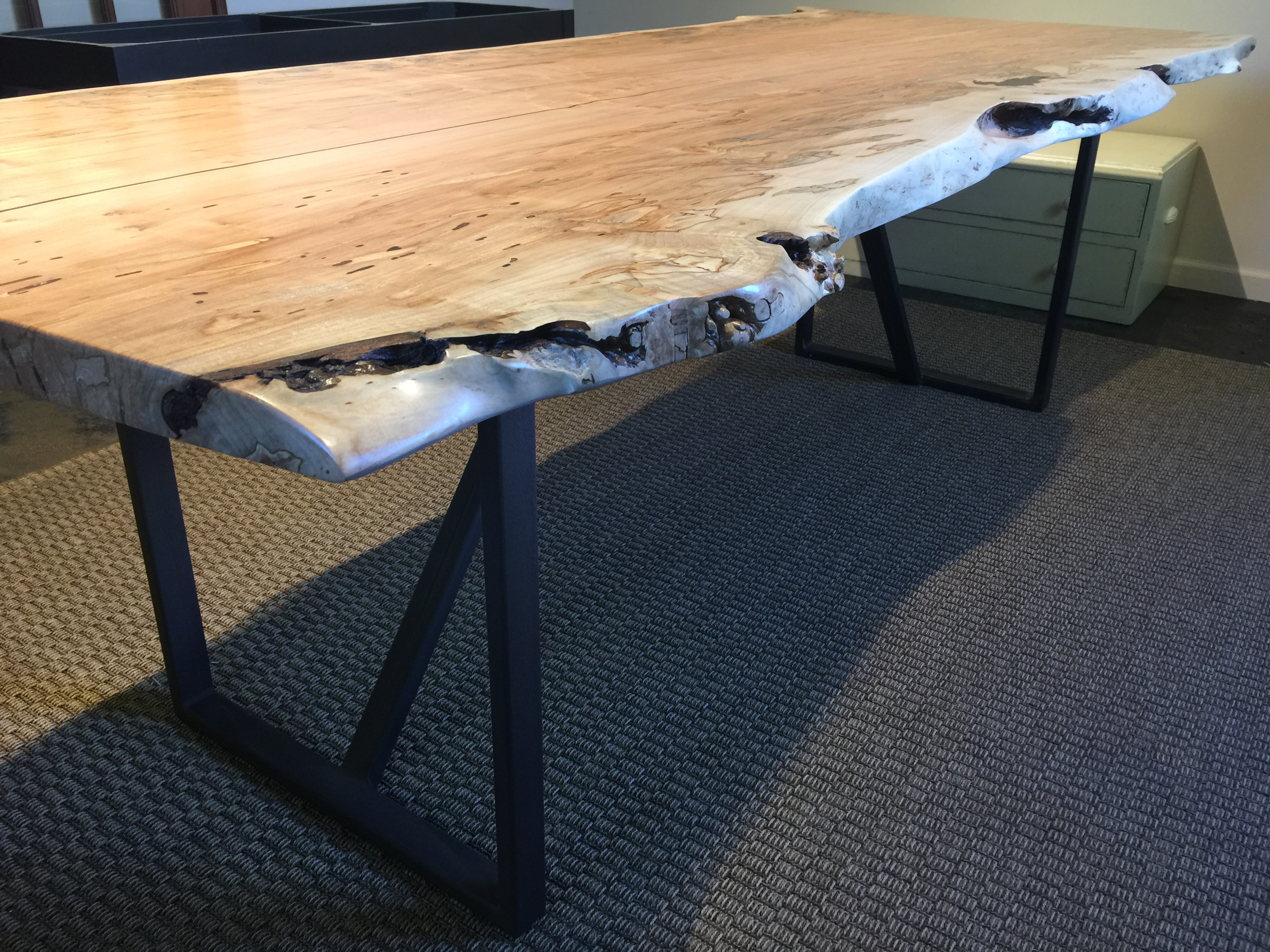 Ambrosia Maple dining table with painted steel legs