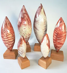 Saggar fired pods with ferric chloride fern decoration.