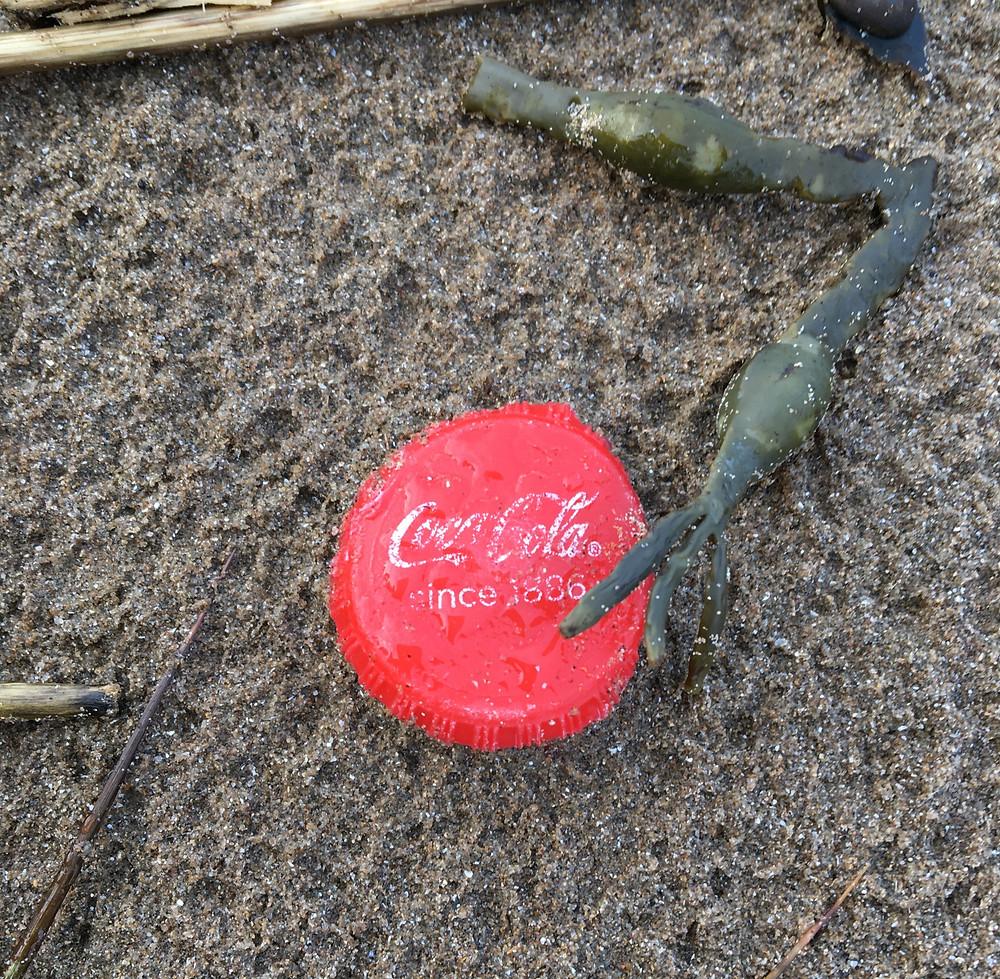 Red plastic coca cola bottle top