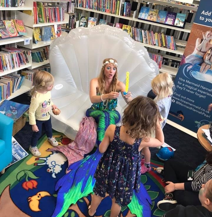 mermaid sitting on giant clam for story time