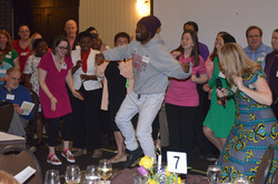 Mohammed airborne with choir smiles