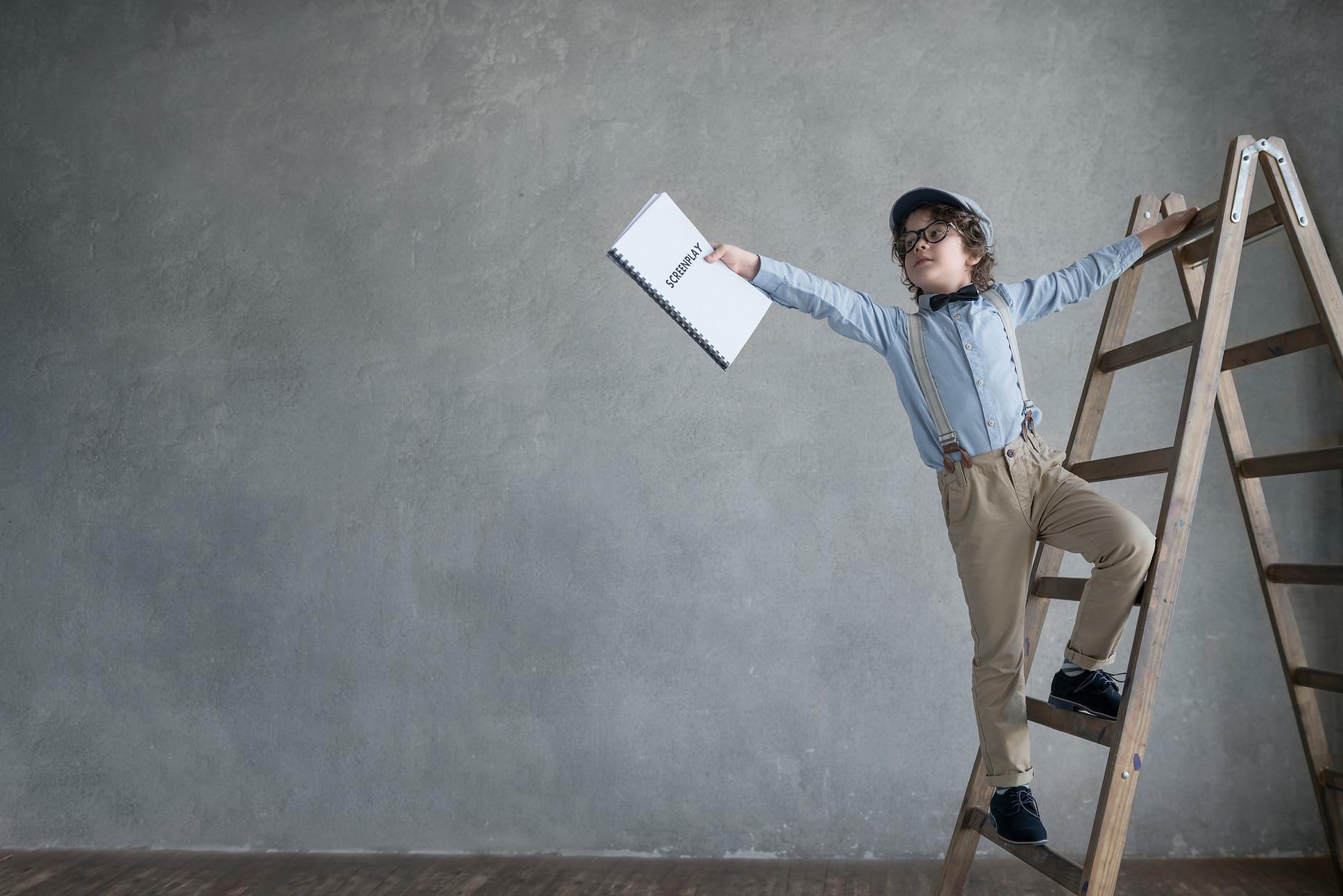 boy-director-on-ladder.jpg