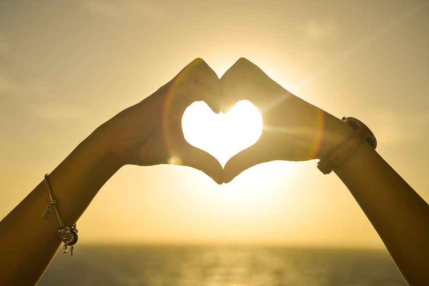 Canva - Two People Forming Heart Sign to
