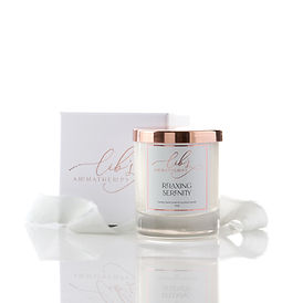 A relaxing scented candle with a rose gold lid