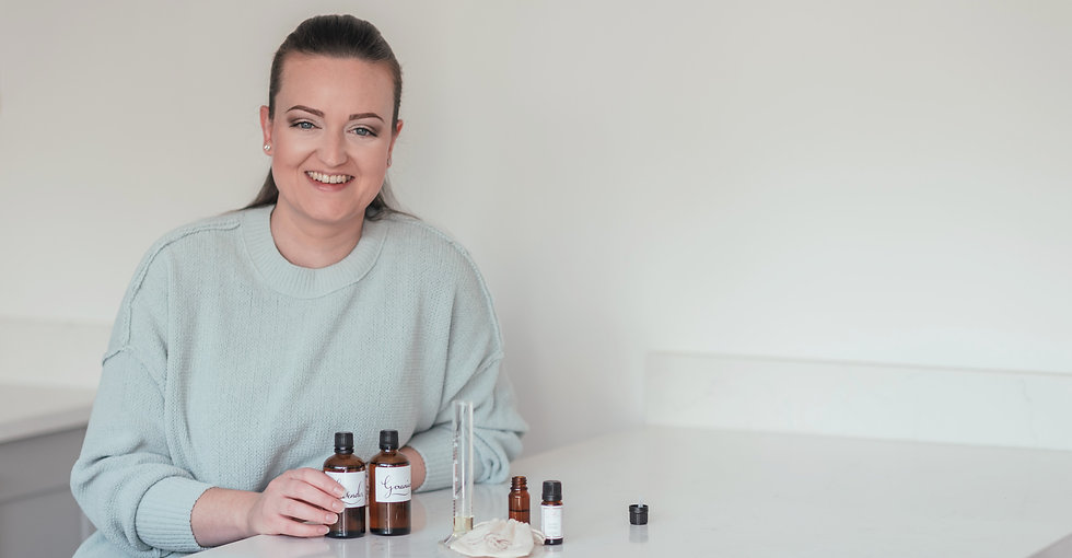 home fragrance brand owner sitting with essential oils
