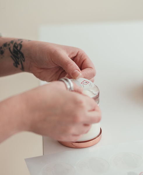 A CLP Label being applied to the base of a scented candle