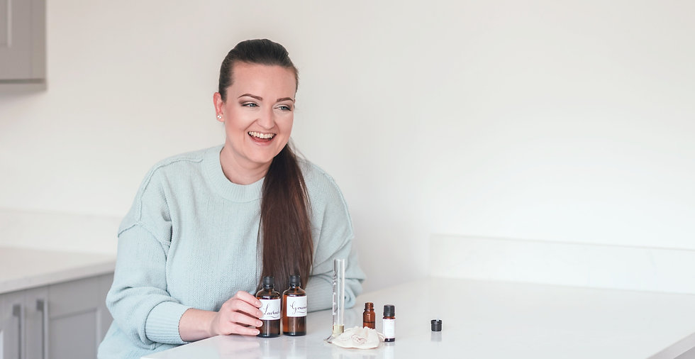 Small business owner sitting at a table with essential oils