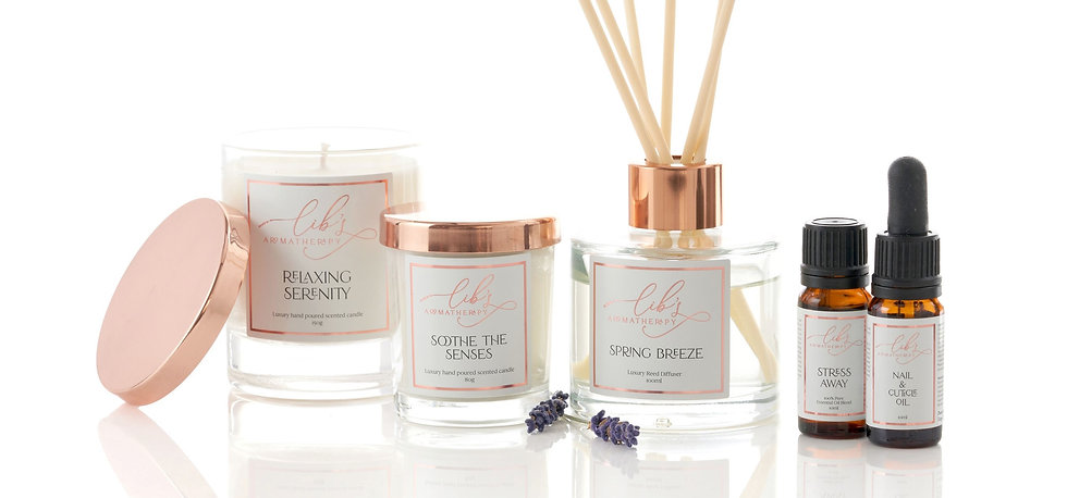 Two scented candles, a reed diffuser, an