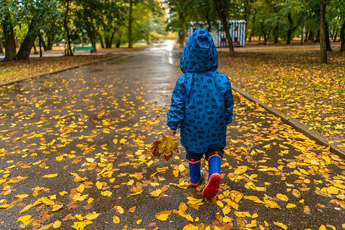 photo-of-kid-wearing-raincoat-while-walk