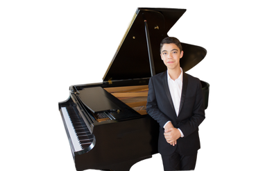 Ethan Bortnick in Front of Piano.png