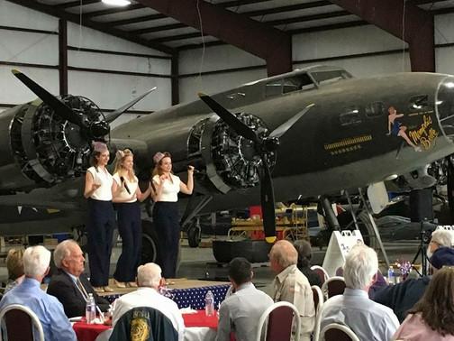 trio singing in hangar.JPG