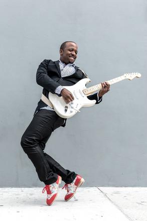 Solomon Jaye w Guitar 2.jpg