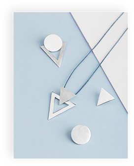 Modern geometric silver necklace and earrings.