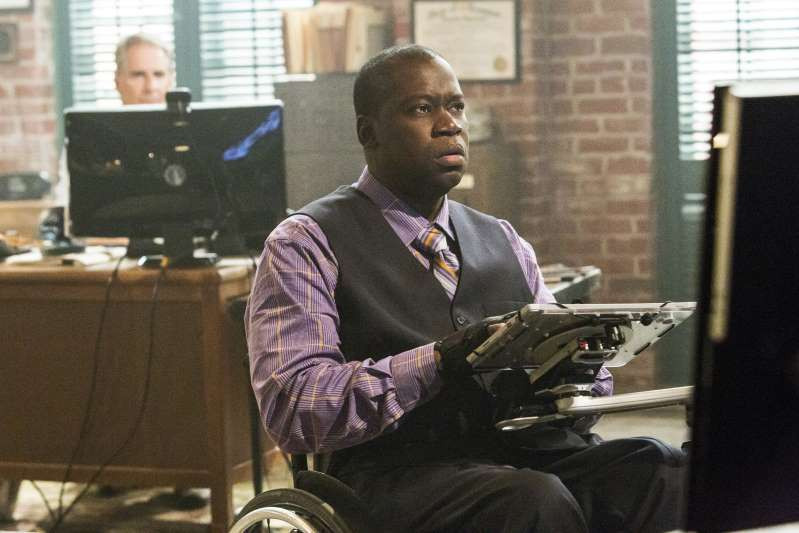 "This image released by CBS shows disabled actor Daryl Mitchell in a scene from ""NCIS: New Orleans."""