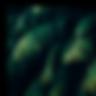 회전하는 회색 돌 뒤에 있는 초록색 야자나무 잎